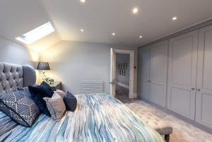 """""""A luxurious master bedroom with a large bed and bedside cabinets"""" with"""
