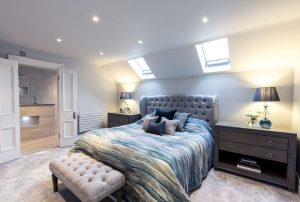"""a master bedroom with door to an en suite bathroom"""