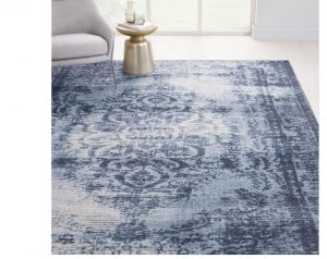 """Rug sourced by Three Interiors blue distressed tones"""
