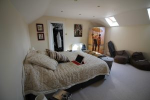 """""""Bedroom featuring screens in the corners of the room"""""""