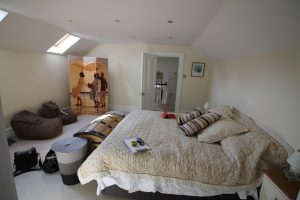 """""""A bedroom with a large bed"""""""