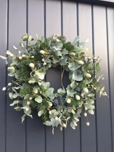 """Christmas wreath on front door with eucalyptus, thistles and spruce"""