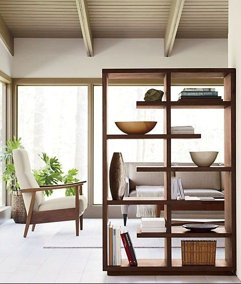 """ A lounge room with a shelving unit used as a room divider"""