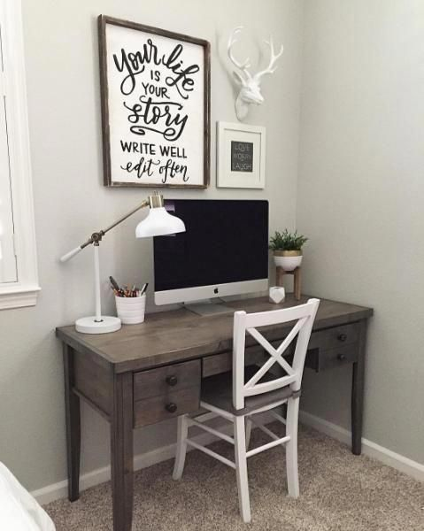 """A small home office in the corner of a room"""